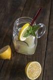 Lemonade glass jar with lemon wedges and straw Royalty Free Stock Photo
