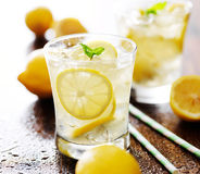 Lemonade in a glass with mint garnish. Shot close up with selective focus royalty free stock image