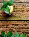 Lemonade in the glass with mint and lemon on the table. Royalty Free Stock Photo