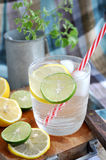 Lemonade glass on wooden board Royalty Free Stock Images
