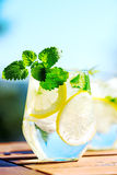 Lemonade in glass. On wooden table Royalty Free Stock Images