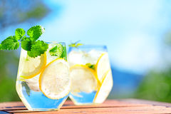 Lemonade in glass. On wooden table Royalty Free Stock Photo
