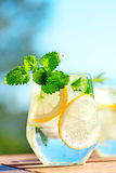Lemonade in glass. On wooden table Stock Images