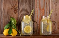 Lemonade Glasses on Shelf with Lemons Royalty Free Stock Photos