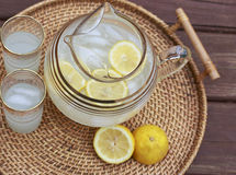 Lemonade and glasses on a table. Pitcher of Lemonade and glasses on a table Stock Image
