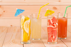 Lemonade and grapefruit juice on table. Stock Photo