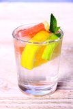 Lemonade with grapefruit, lime, lemon and ice Royalty Free Stock Image