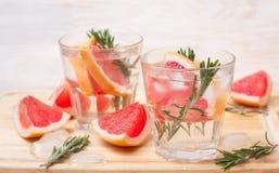 Lemonade with grapefruit and rosemary Stock Photos