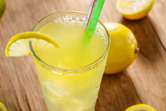 Lemonade with a green straw Stock Image