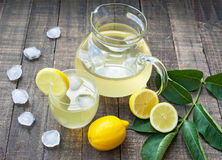 Lemonade. With ice in glass and pitcher Stock Photos