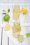 Lemonade in jar with slices of lime Stock Photography