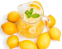 Lemonade in the jug and lemons with mint Royalty Free Stock Photo
