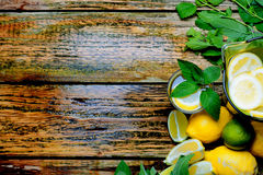 Lemonade in the jug with mint and lemon on the table. Royalty Free Stock Photo