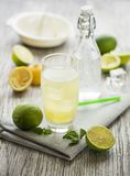 Fresh Lemonade juice with lemon and lime stock photo