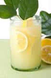 Lemonade with Lemon Leaves Stock Photos