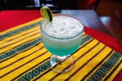 Lemonade, lemon liquados in glas on table with traditional cloth, Lago Atitlan, Guatemala. Lemonade, lemon liquados in glas on table with traditional striped royalty free stock image