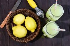 Lemonade and lemons Stock Images