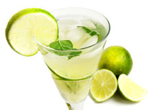 Lemonade with lime. Isolated on white background Royalty Free Stock Images