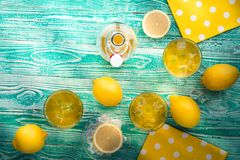 Lemonade or limoncello in glasses Royalty Free Stock Images