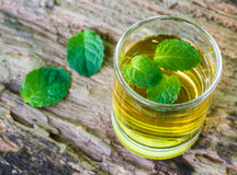 Lemonade with mint on a dark wood Royalty Free Stock Image