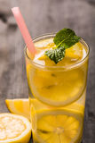 Lemonade with mint leaves and straw Stock Photos