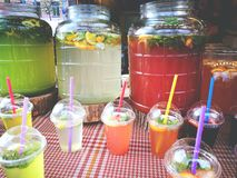 Lemonade with mint and lemons space  in plastic glass  with straws street food Royalty Free Stock Photo