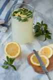 Lemonade with mint. Soft drink with mint and lemons in the jar royalty free stock images