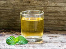 Lemonade with mint on a wood background. Royalty Free Stock Photography
