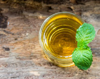 Lemonade with mint on a wood background. Stock Image
