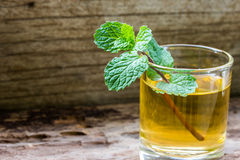 Lemonade with mint on a wood background. Royalty Free Stock Photos