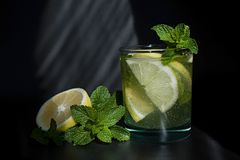 Lemonade or mojito cocktail with lemon and mint, cold refreshing drink or beverage with ice royalty free stock photos