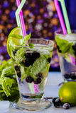 Lemonade mojito with lime, blackcurrant and mint Royalty Free Stock Photos