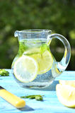 Lemonade in the pitcher. Stock Photos