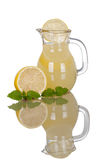 Lemonade Pitcher and Glass with Lemons and reflection Stock Photos