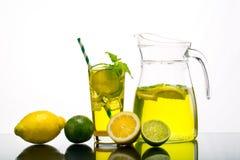 Lemonade pitcher with lemon stock images
