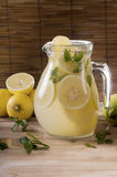 Lemonade pitcher with lemon slices Royalty Free Stock Photography