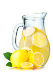 Lemonade pitcher with lemons Royalty Free Stock Photography