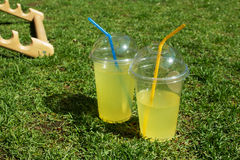 Lemonade in plastic cup. On food festival Stock Photos