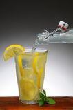 Lemonade Pouring from Bottle Royalty Free Stock Photo