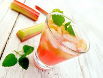 Lemonade with rhubarb and mint in glassful on board Royalty Free Stock Images