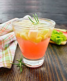 Lemonade with rhubarb and rosemary on table Stock Photos