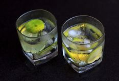 Lemonade served on a dark marble bar with a lime Royalty Free Stock Photos