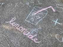 Lemonade sign painted with chalk on the ground Royalty Free Stock Image