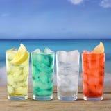 Lemonade soda drinks on the beach and sea Royalty Free Stock Photography