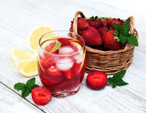Lemonade with strawberries Stock Images