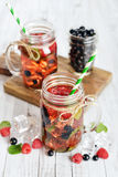 Lemonade with summer berries Stock Photo