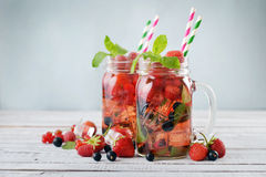 Lemonade with summer berries Stock Photography