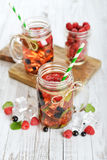 Lemonade with summer berries Stock Images