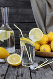 Lemonade in a transparent glass and lemons on a  wooden table Royalty Free Stock Photo