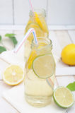 Lemonade in two jars with slices of lime and lemon Royalty Free Stock Image